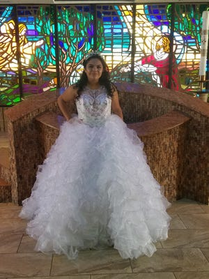 Carla Ballesteros at her quinceañera, a tradition of celebrating a young girl's 15th birthday.