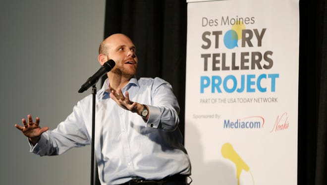 Brad Biren tells his story of about growing up feeling like a foreigner in his own country Thursday, June 7, 2018, during the Des Moines Storytellers Project at Curate in Des Moines.