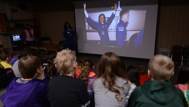 """NASA astronaut Sunita """"Suni"""" Williams talks over a slideshow of images from her time at the International Space Station."""