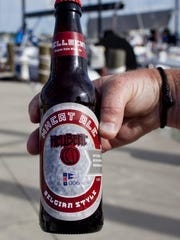 A home-brewed beer is labeled with the Hell Bent logo Thursday, July 16, 2015 at the Port Huron Yacht Club.