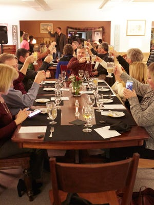 Guests share a toast at the conclusion of Eat+Drink's January Secret Supper at the Amish Showroom Furniture Thursday, Jan 26, 2017.