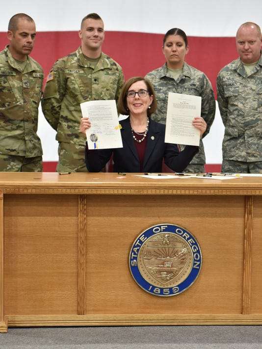 Oregon Governor Kate Brown cermeniously signs State Tuition Assistance Bill for Oregon National Guard