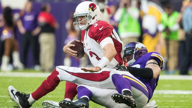 Nov 20, 2016; Minneapolis, MN, USA; Cardinals quarterback Carson Palmer (3) is sacked by Vikings defensive end Brian Robison (96) during the third quarter at U.S. Bank Stadium. The Vikings defeated the Cardinals 30-24.
