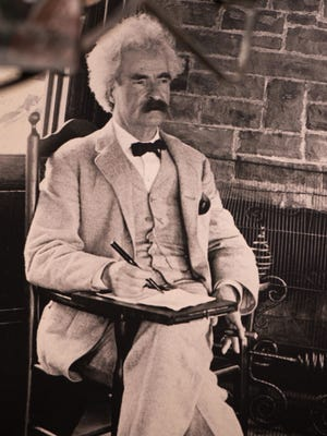 Mark Twain wears a white suit in his study in Elmira in this undated photo.