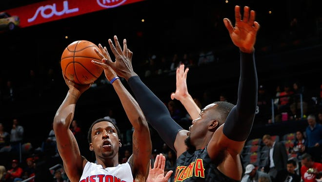 Kentavious Caldwell-Pope, left, of the Detroit Pistons shoots against the Atlanta Hawks at Philips Arena on Oct. 27, 2015, in Atlanta.