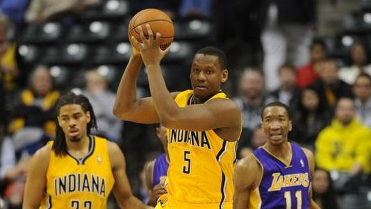 Lavoy Allen securing the basketball during a win against the Los Angeles Lakers. Last season, Allen appeared in 14 games for the Pacers.