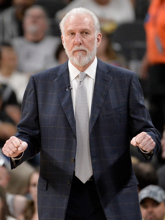 San Antonio Spurs head coach Gregg Popovich signals to his players during the first half of an NBA basketball game against the Utah Jazz, Sunday, April. 2, 2017, in San Antonio. (AP Photo/Darren Abate)