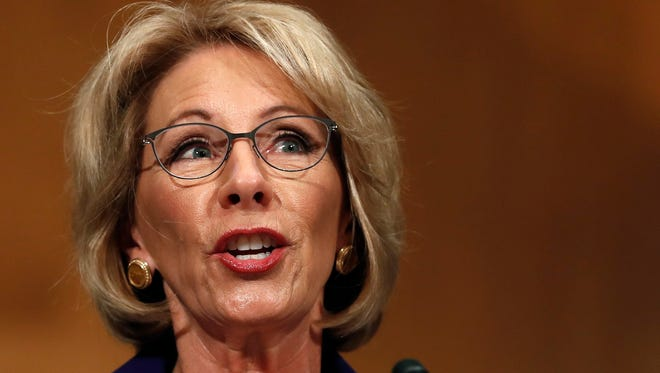 Betsy DeVos testifies on Capitol Hill in Washington, Tuesday, at her confirmation hearing for education secretary.