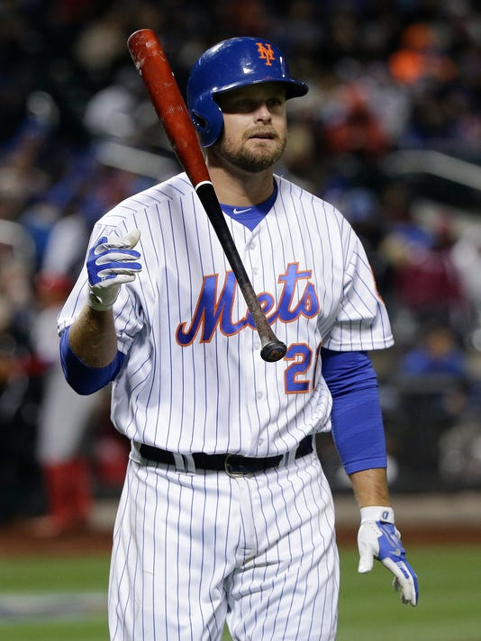 New York Mets' Lucas Duda flips his bat after striking out to end the eighth inning of a baseball game against the Philadelphia Phillies, Saturday, April 9, 2016, in New York. The Phillies won 1-0. (AP Photo/Julie Jacobson)