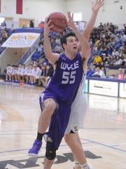 Wylie forward Kyle Roberts (55) goes in for a basket