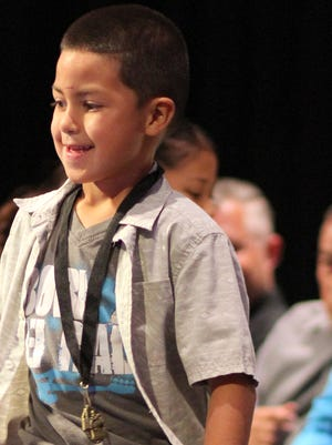 Students proudly walked off stage wearing medals awarded on Thursday at the fifth annual Literacy Showcase held at the Deming Public Schools Auditorium.