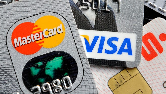 Credit card debt is at a nearly five-year high as consumers feel more comfortable relying on credit and are taking out new cards, according to data from credit reporting agencies.