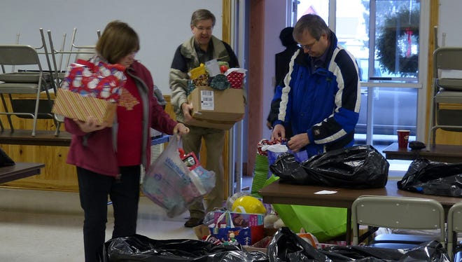 Mansfield University volunteers sort items for Santa's Gift Bag in Mansfield on Tuesday.