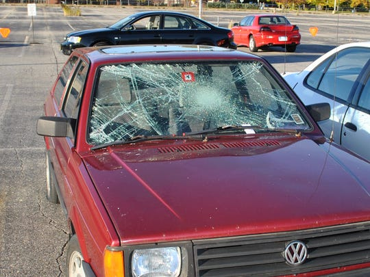 A car that has been vandalized sits in Gilburn lot