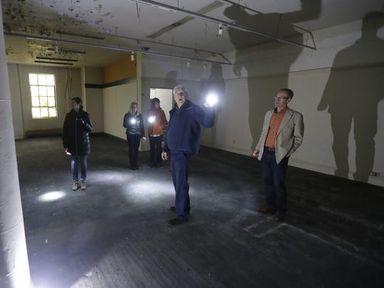 Prospective investors tour the Schauer & Schumacher building on Adams Street Thursday in downtown Green Bay. The city and Downtown Green Bay Inc., are seeking investors for the historic downtown property.