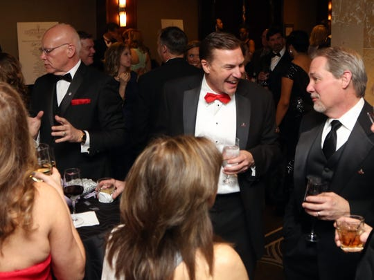 Candlelight Ball attendees mingle during cocktail hour before the start of the program Saturday March 11, 2017 at the Downtown Hilton.