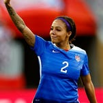Forward Sydney Leroux  waves to the crowd after one of the Americans' World Cup matches in Winnipeg.