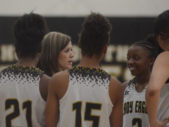Abilene High coach Terri Aston talks to her team during