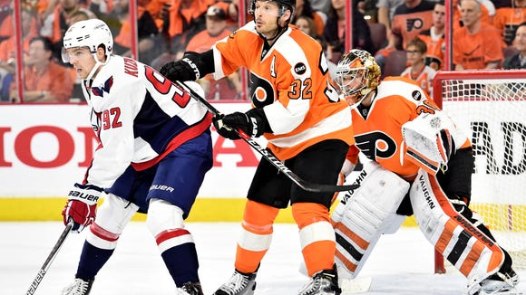 Mark Streit, center, and goalie Michal Neuvirth are both close to returning from injuries.