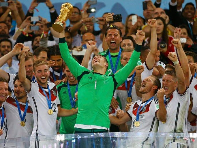 Germany goalkeeper Manuel Neuer lifts the trophy.