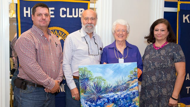 The Kiwanis Club of Abilene presents a painting by Jack Harkins to out-going president Nancy Miller. From left: Robert Pritz, Jack Harkins, Nancy Miller and Gayla Mize.