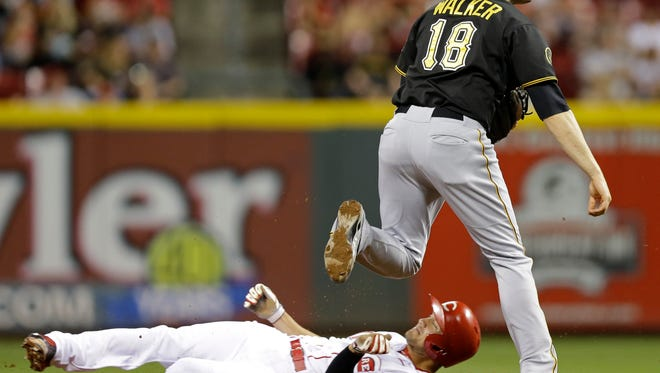 Pirates second baseman Neil Walker throws to first to complete a double play after forcing out the Reds' Kristopher Negron at second in the third inning Friday at GABP.
