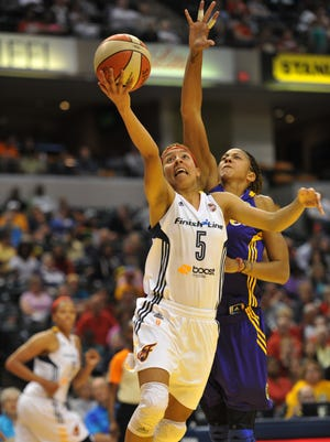 Indiana Fever's Layshia Clarendon drives to the basket past Los Angeles Sparks' Candace Parker on July 15, 2014, Bankers Life Fieldhouse, Indianapolis. The Fever lost 86-78.