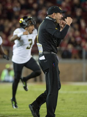Oregon Ducks head coach Mark Helfrich (right) and former quarterback Vernon Adams Jr. (3) celebrate during a game last season.