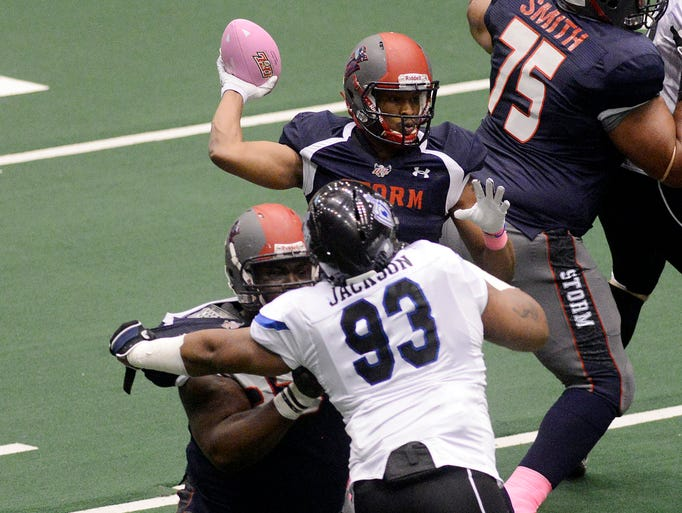Storm quarterback, Chris Dixon throws a pass as they play Cedar Rapids in Saturday night's game at the Sioux Falls Arena, May 10, 2014.