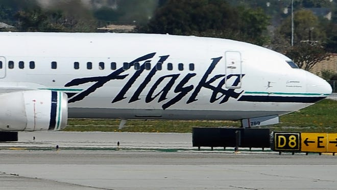 An Alaska Air jet prepares to take off in this file photo.