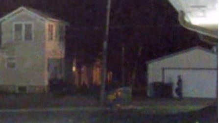 Topeka police on Friday made public this image of a person, walking near a garage door, whom they hope to identify and question regarding a double homicide committed July 14 in the 500 block of S.W. 5th.