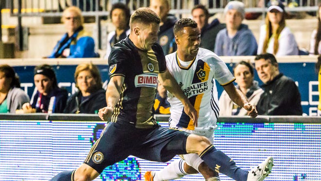Philadelphia's Keegan Rosenberry (left) tries to fight the ball away from LA's Ashley Cole in the second half of a 2-2 draw between the Philadelphia Union and the LA Galaxy at Talen Energy Stadium in Chester, Pa. on Wednesday night.