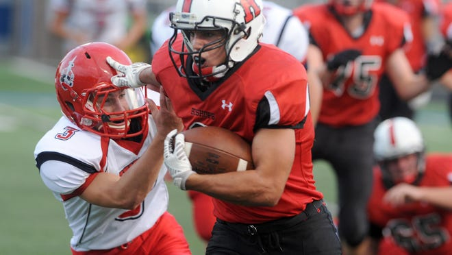 Rosecrans' Travis Johnston stiff arms Fairfield Christian's Ross Brant on his way in for a touchdown Saturday in Zanesville. Johnston finished with 279 yards on 30 carries and five touchdowns in the 44-0 victory over Fairfield Christian.