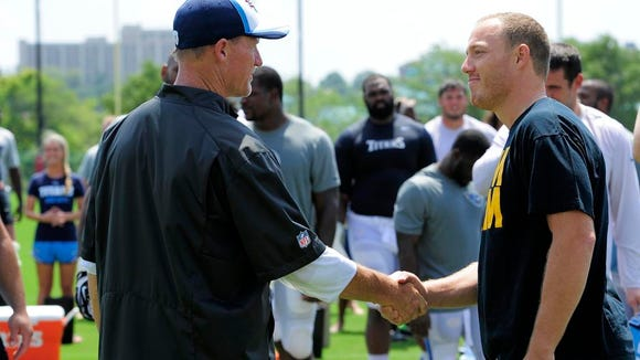 Titans coach Ken Whisenhunt shakes hands with former Titans linebacker Tim Shaw before the team took the ALS Ice Bucket Challenge after practice on Wednesday.
