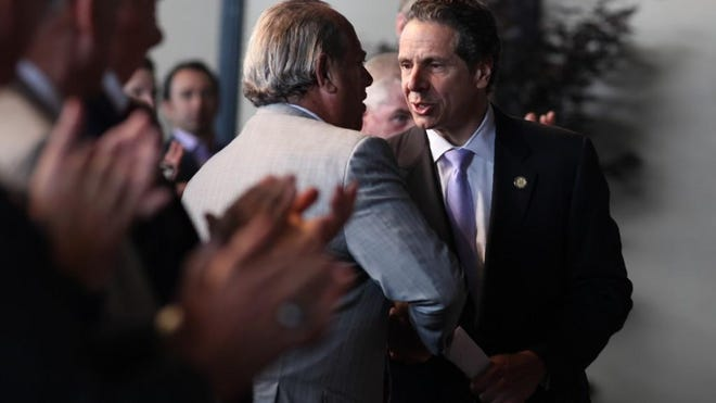 Gov. Andrew Cuomo and Richard Sands shake hands during Tuesday's announcement for funding of the North Shore project.