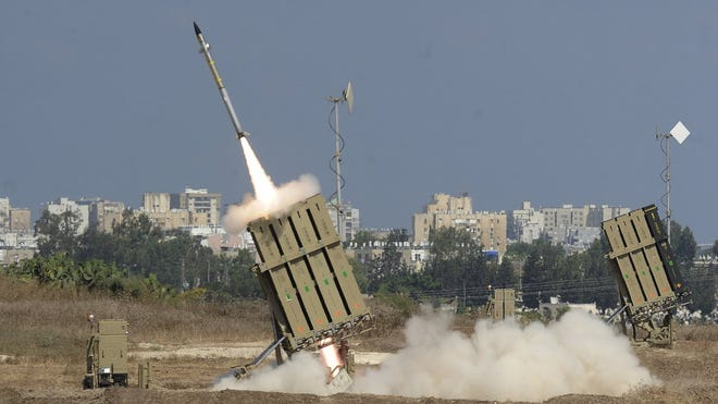 A missile is launched by an 'Iron Dome' battery, a short-range missile defense system designed to intercept and destroy incoming short-range rockets and artillery shells, on July 9 in the southern Israeli city of Ashdod, neighboring the Gaza Strip.