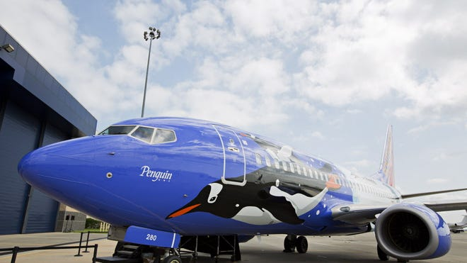 Southwest Airlines debuts its newest specialty plane, Penguin One, in celebration of 25 years of partnership with SeaWorld Parks & Entertainment in Orlando, Fla., in 2013.