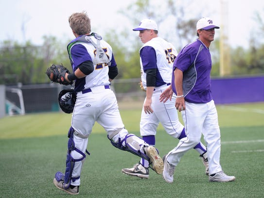 Wylie pitcher Blake Smith (45) gets a high-five from