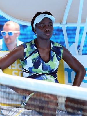Venus Williams of the US takes a break during her match against Johanna Konta of Britain in the first round match on day two of the Australian Open tennis tournament in Melbourne, Australia.