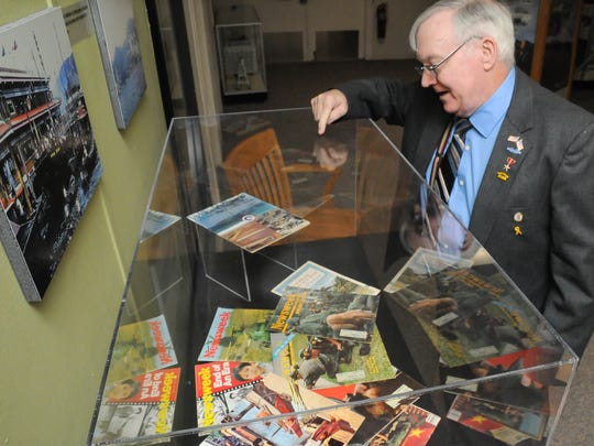 """Vietnam veteran Joe O'Hanlon looks at Newsweek magazines from 1968, all featuring Vietnam. The magazines were on display at WSMR Museum as part of the """"""""Vietnam Through a Different Lens"""" exhibit."""