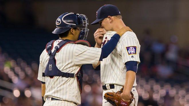 Minnesota Twins catcher Kurt Suzuki (8) talks to starting pitcher Tyler Duffey (56) in the third inning Wednesday against the Detroit Tigers at Target Field in Minneapolis.
