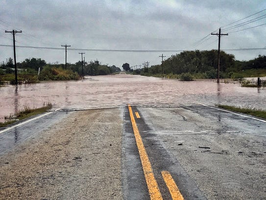 Flood waters from China Creek cover State Highway 25