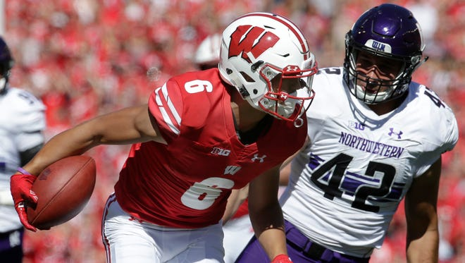 UW freshman wide receiver Danny Davis has three receptions of 30 yards or longer this season, including this 32-yarder against Northwestern on Sept. 30.