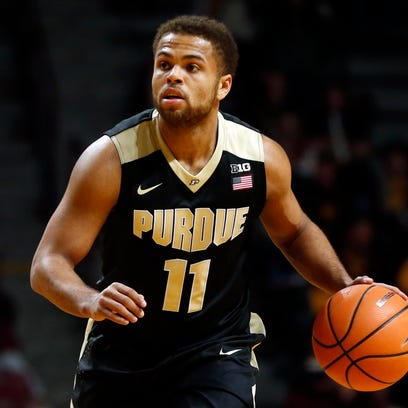 Purdue's P.J. Thompson plays against Minnesota in the