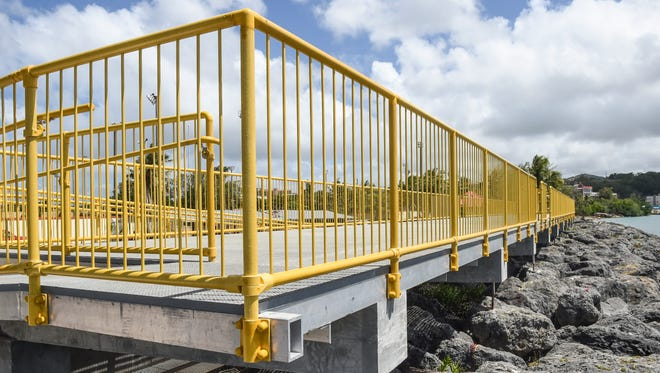 The newly finished, 137-by-15-foot viewing platform is opened for use at Paseo on May 12. Phase two of the project, set to begin this summer, will add a separate fishing platform, according to Matthew Sablan, acting director of the Department of Agriculture.