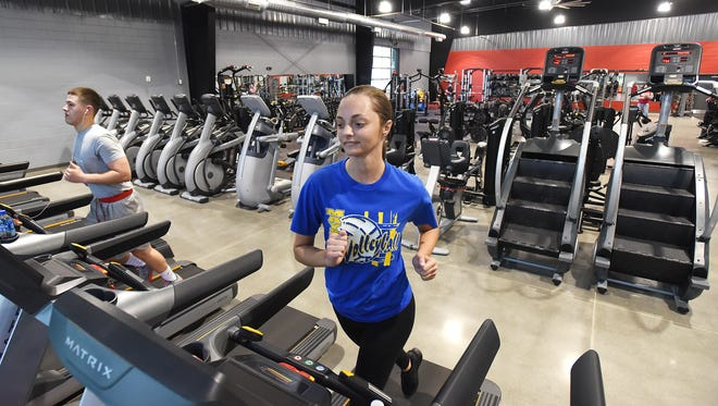 Mylie Swauger runs on a treadmill at the new Southtown Gym in South Zanesville.