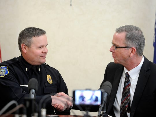 Lieutenant Matt Burns is congratulated by Chief Doug Barthel on his new position as Assistant Chief of Sioux Falls Police Department in Sioux Falls, S.D., Thursday, Feb. 5, 2015.