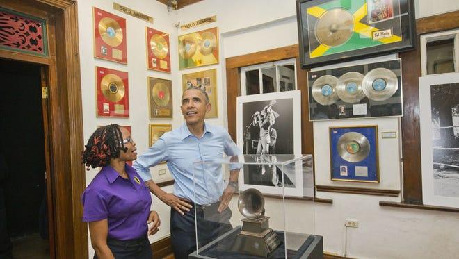 President Obama visits the Bob Marley Museum with tour guide Natasha Clark.