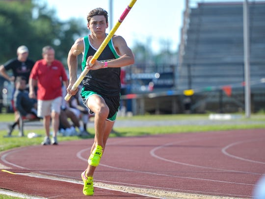 Armand Duplantis competes in the pole vault event at