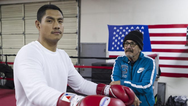 Rudy Puga Jr. is pictured with trainer Max Garcia during a recent training session in Salinas.